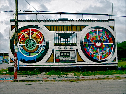 The iconic boom box by Chor Boogie and Trek6, visible from I-95, painted on and abandoned two story building.